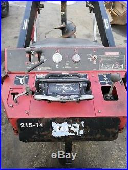 Toro Dingo TX425 skid steer crawler loader. With toro auger